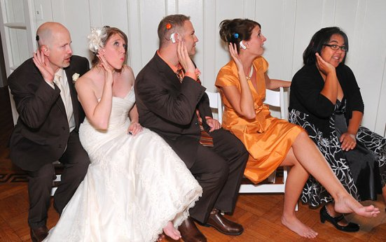 At the wedding of Todd and Abbie Hlavacek (couple at left), friends with cochlear implants from Advanced Bionics joined together in showing off their bionic ears. Todd received his implants in January 2010 and January 2012, Abbie in August 2007, Gregg Hlavacek (center, no implant), Jennifer Thorpe (second from right) in November 2007, and audiologist Tina Childress in August 2000 and December 2005. Way to Show Me Your Ears, friends!
