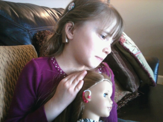 Makena the American Girl doll and her best human friend have a lot in common. They like the colors purple and pink... and they both love to Show Me Their Ears.