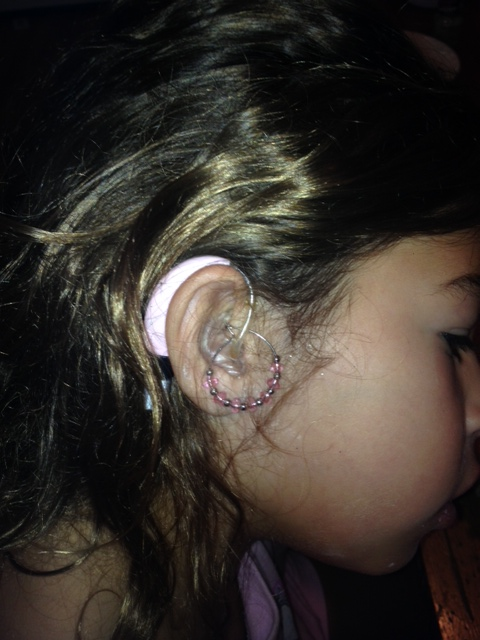 "Isabella, age 8, has worn hearing aids since she was 2. Mom Lauren writes, ""Thankfully. she has never tried to hide them and we have made a point to make her feel proud of her hearing aids."" Beautiful attitude, Isabella and Lauren!"