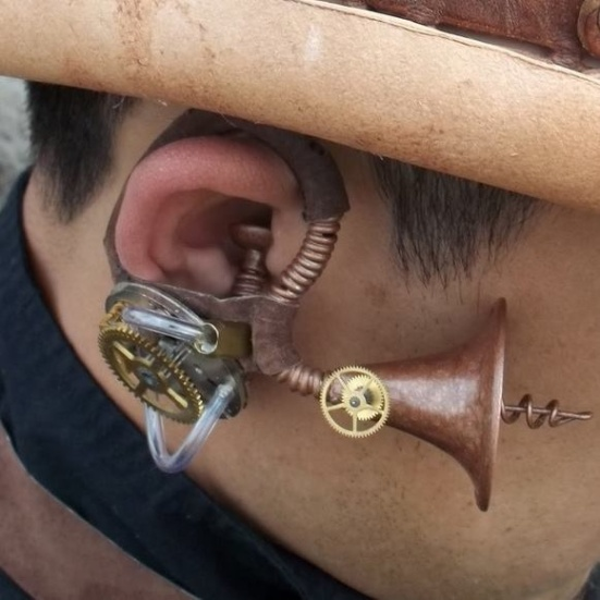 "The Phonak Facebook page posted this clever ear photo found on Pinterest. ""Steampunk is a sub-genre of science fiction that typically features steam-powered machinery like those found in the works of H. G. Wells and Jules Verne. What do you think of this Steampunk inspired Hearing Aid?"" Phonak asked its followers. Lipreading Mom thinks it rocks!"