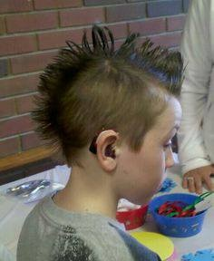 Check out young Nick's super-cool hearing aid. Love the mohawk, too!