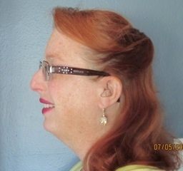 Christine Carver proudly wears her new Starkey Ignite Wireless hearing aids with SurfLink hand remote.