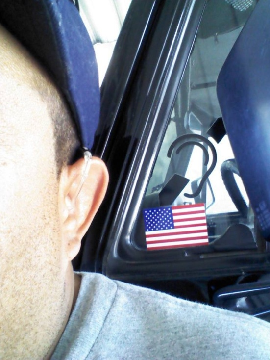 David Villegas shows me his ear ... and his American patriotism.