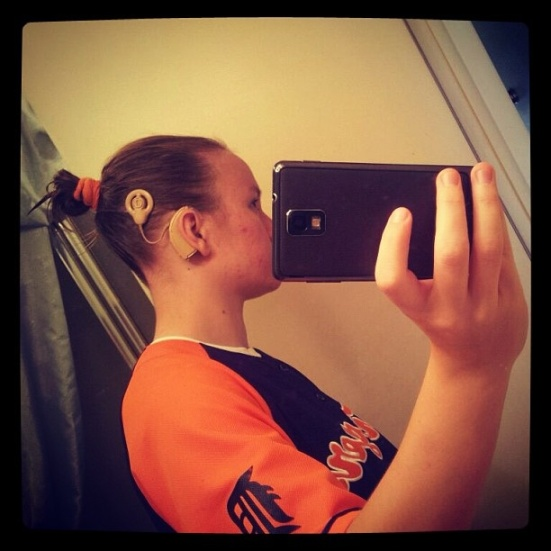 What's more fun than posing for Show Me Your Ears? Snapping your own profile in the mirror! Rikki has worn a cochlear implant for 16 years. Now that's what I call a Kodak moment. ;)