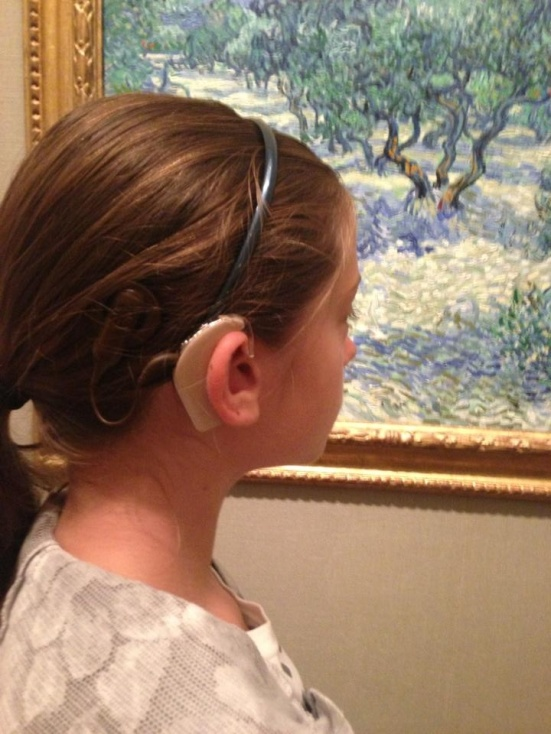 "Lipreading Mom doesn't know which to admire more: ""The Olive Orchard"" by Van Gogh or young Lily's beautiful profile for Show Me Your Ears."