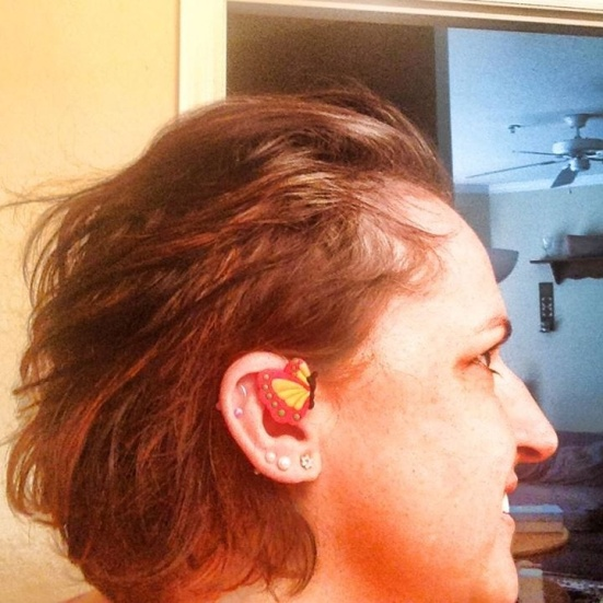 Why just watch butterflies when you can wear them? Marie Myers blings her hearing aids with the beautiful winged creatures.
