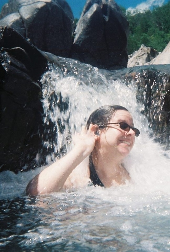 "Kristen makes a splash with her aquatic, waterproof 'ears.' ""I waited 30 years to be able to hear while swimming with my Aquaris hearing aids!"""