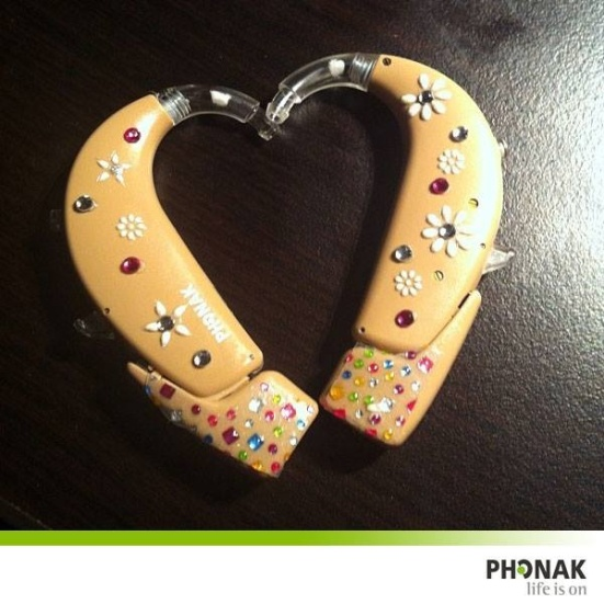 Can you feel the love for Show Me Your Ears?  Abby Sienko shows off her heart and soul with these Phonak hearing aids.