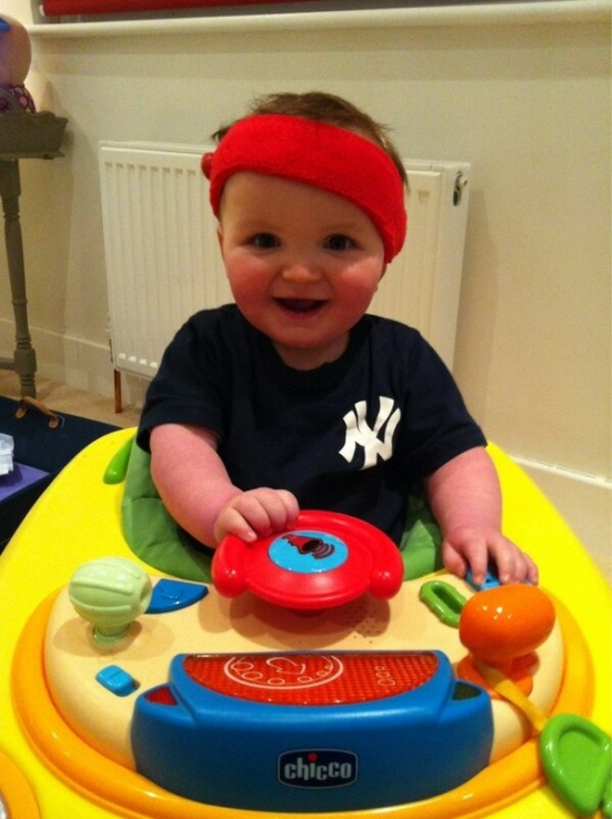 Look at this 10-month-old cutie pie's headband hearing aids and adorable smile!