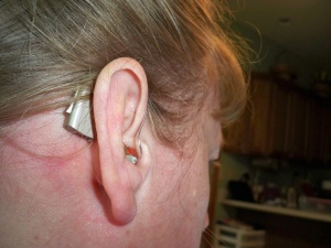 "Julie has been wearing hearing aids since the age of five. She writes, ""I am now wearing Oticon Epoq and have had these hearing aids for five years.  I have had hearing aids for 40 years...and only wore one hearing aid in my left ear (most of those years).  I went to wearing two hearing aids when I got the Oticon Epoq.  Because of wearing hearing aids for long, I have seen how the technology has changed over the years. It is pretty amazing!"""