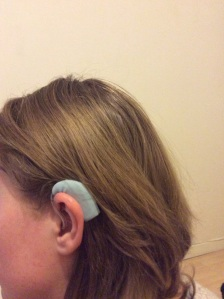 This Phonak Nathos hearing aid is worn by UK hearing loss blogger Liz Fisher, who is an awesome supporter of the Lipreading Mom blog. Thanks, Liz!