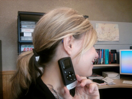 I pose for Show Me Your Ears with my new ReSound Verso hearing aids and wireless remote control.