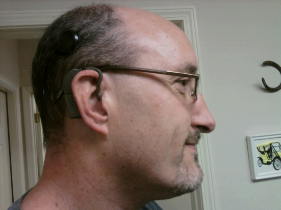 Proudly wearing a cochlear implant, Chris Kurz is the technology innovations coordinator at sComm, developer of the UbiDuo device for the Deaf and hard of hearing. Lipreading Mom is honored to use the UbiDuo at home and will blog about her experiences soon.