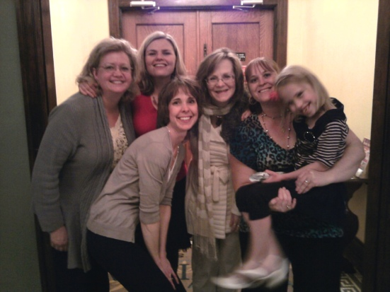In February, a caravan of friends and family drove with me to Atchison, Kansas, at my speaking event for the first-ever Grace & Girlfriends women's retreat. Live captioning was provided by volunteer/friend Donna (kneeling, front). Do you spot Lipreading Mom standing on tiptoes in the back?