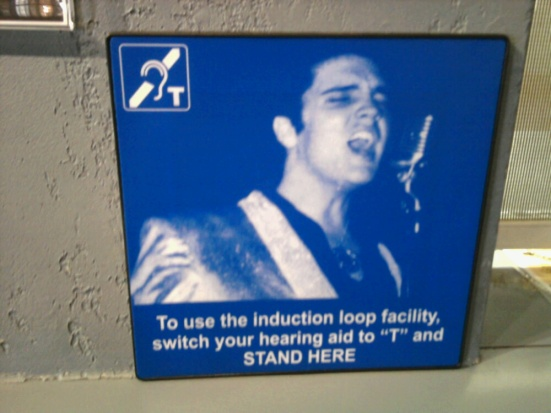 While on a family trip to Graceland this spring, I heard Elvis' magnificent voice crystal-clear, thanks to facility-wide looping and captioning.