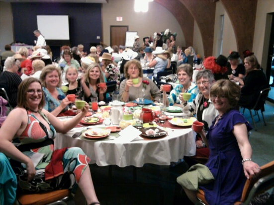 The first-ever Deaf Women's Tea was held in Kansas. My table mates consisted of sign language interpreters, Kansas School for the Deaf staff...and my darling little girl. This was my first experience with having a sign language interpreter devoted strictly to communicating with me.