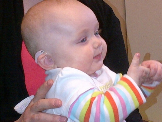 This baby girl is 'Pretty in Pink'...hearing aids, that is.