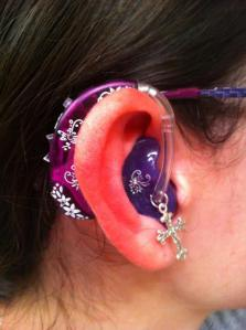 Pink purple hearing aid with charm