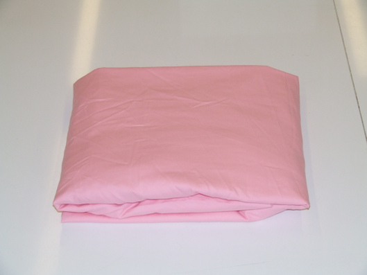 Evidently a newly laundered fitted sheet can look like this after folding...