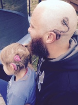 Dad Receives a Tattoo to Match His Daughter's Cochlear Implant